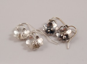 Flower earrings, in both shiny and antiqued finishes