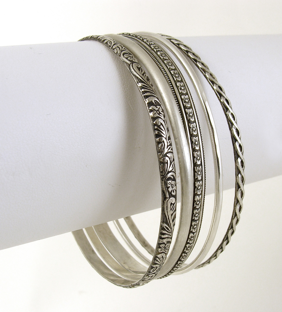 variety of patterned sterling silver bangles