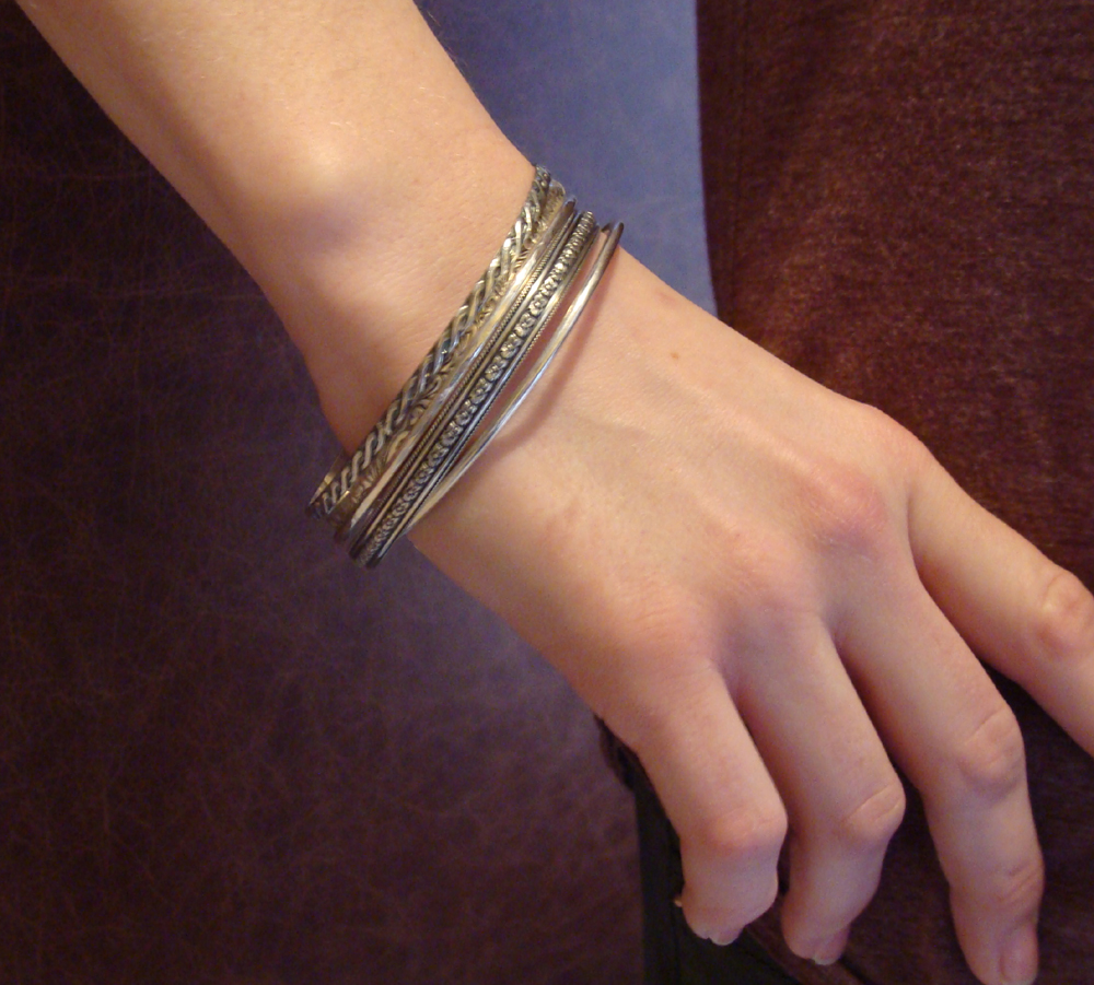 woman wearing variety of bangles