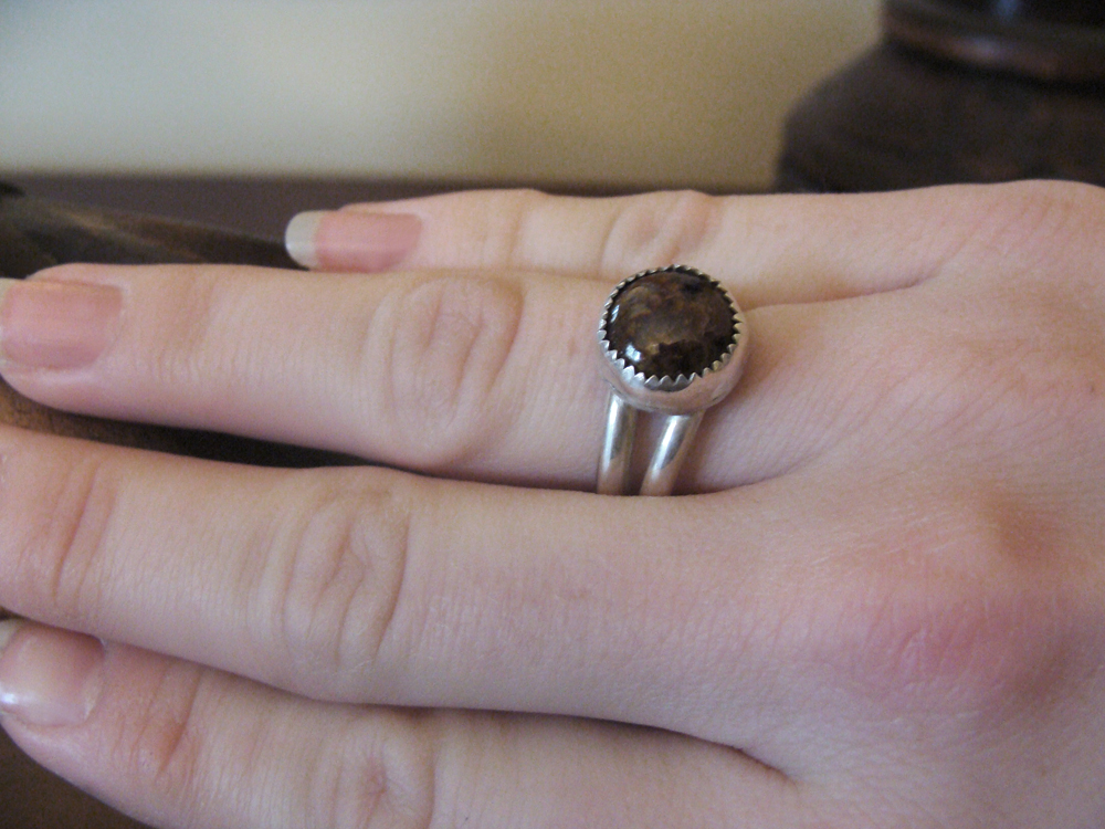 Earthy brown Pietersite sterling silver ring, on woman's hand