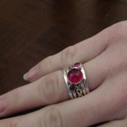 Ruby and garnet ring set on woman's hand