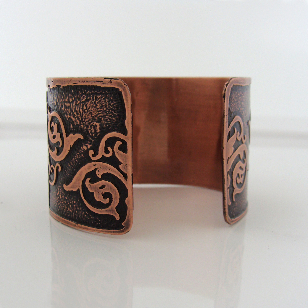 Back of fleur-de-lis copper cuff