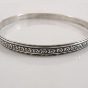 close up of sterling silver floral bangle