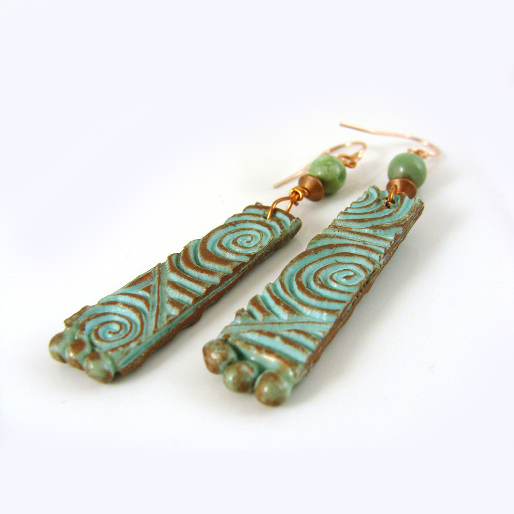 Textured turquoise patina earrings front view