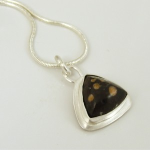 Brown spotted trillion pendant