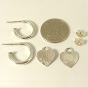 small sterling silver hoop earrings and heart charms with dime for size comparison